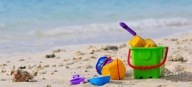 children-toys-lying-around-at-the-beach