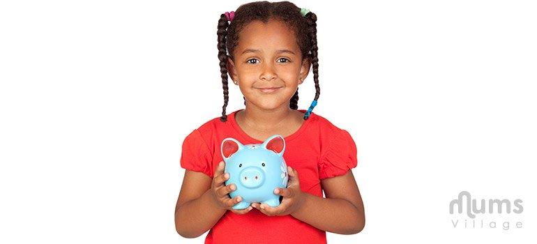 Cute girl holding piggy bank