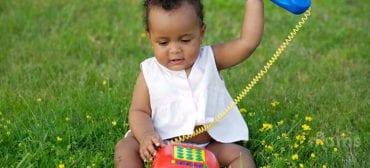 toddler using toy phone