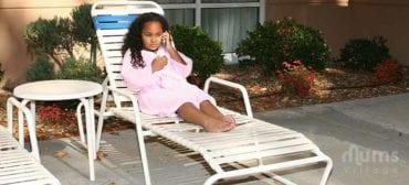 girl in pink robe using phone