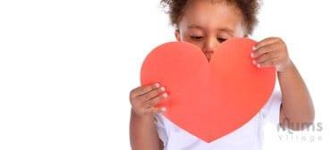 cute-boy-holding-paper-heart