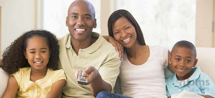 father-holding-Tv-remote-confrol-with-his-family