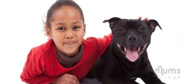 girl-with-black-pet-dog