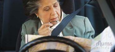 elderly woman reading map