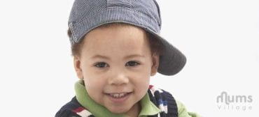 cute boy wearing cap