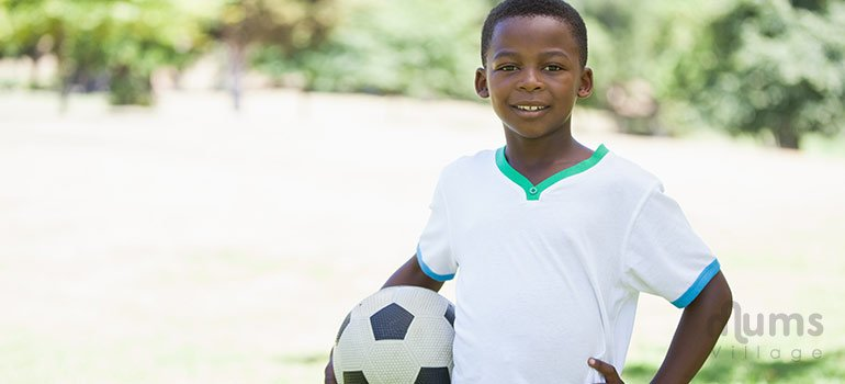 African-boy-holding-football-outdoors - Copy