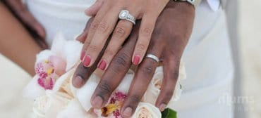 Husband-and-wife-hands-with-wedding-bands