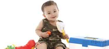 cute-smiling-baby-playing-with-toys