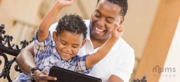 father-son-playing-on-tablet