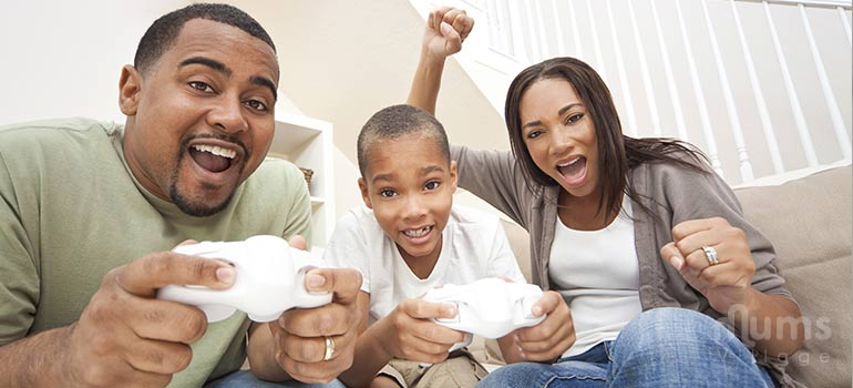 happy-black-family-playing-video-games