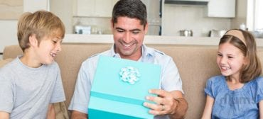 happy-white-father-receives-a-gift-from-children