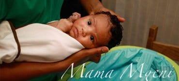mama-mgeni-husband-washing-baby